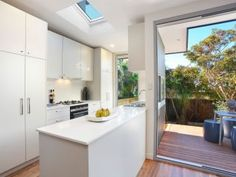 timber floors, skylights, CaesarStone benches, gas kitchen