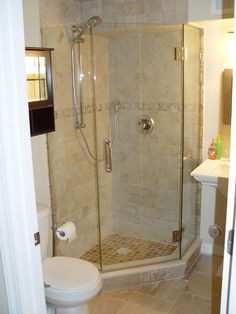 tiled corner shower except with pennies on the floor of the shower