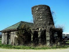 Top 20 Ghostly Houses Standing in Silence Around the World An abandoned farm house and water tower consumed by ivy. Riverhead, New York