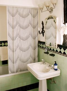 Bath curtain fabric looks perfect with original tile