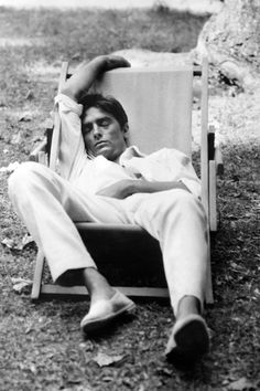 Alain Delon takes a nap during a filming, on December 31, 1964.