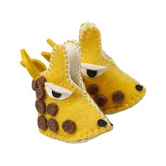 Giraffe Zooties Baby Booties - Fair Trade - #fairtrade #shopfairtrade #thisbluesea  These Giraffe Zooties are handcrafted from locally sourced sheep's wool in Kyrgyzstan. They are the perfect natural and environmentally conscious baby shoe.  Made for babies up to 12 months.  Meet the Artisans  The Silk Road Bazaar Silk Road Bazaar is a wholesale representative of marginalized artist groups located in Kyrgyzstan and throughout Central Asia. They connect with artists who are far from the…