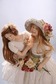Darling little sister dolls...   This gal, Laura Scattolini, has made some gorgeous dolls... and that's coming from a woman who's not a huge doll lover.