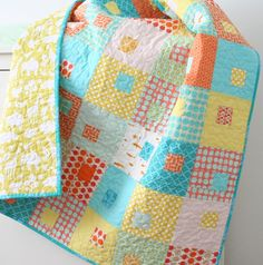 I love this quilt….especially for a little boy (or girl) toddler bed. This one is a crib size, I thought maybe it would be mega cute on my Ryan's toddler bed someday….except I already have his circ…