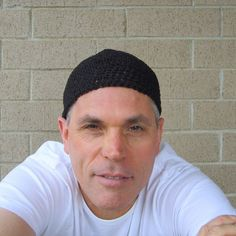 I hand crocheted this extra short kufi with pure black hemp yarn- it measures 6 long (just above your ears) and will fit (or stretch to fit) most average size heads (20-23 in circumference)- we are happy to make you a custom size (at no extra cost!). 6= 15.24 centimeters long 20-23= 50.80- 58.42 centimeters in circumference  this hat was made with care, attention to detail and nice quality hemp yarn which will keep you cool in the summer and warm in the winter- hemp is one of the m...