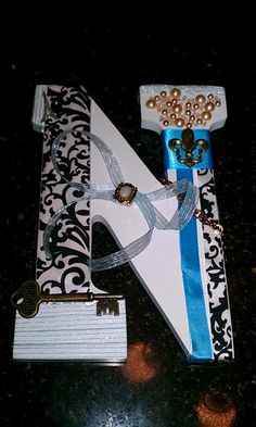 Teen craft...so cute! you can get the cardboard letters at Hobby Lobby and use scrapbook paper and doo-dads decopage the paper on and hot glue the doo dads