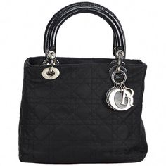 For Sale on - The Lady Dior handbag features a nylon body, rolled leather handles with silver-tone metal hardware, a top zip closure, and interior zip pocket. Fall Handbags, Dior Handbags, Canvas Handbags, Handbags Online, Fashion Handbags, Purses And Handbags, Lady Dior, Brand Name Bags, Wholesale Handbags