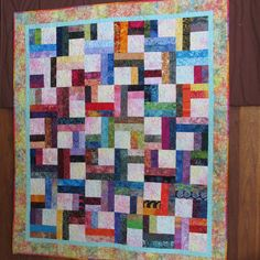 2018 - Peggy's Two Step.  Pattern:  MSQC.  Center squares of each block and outer border are new fabric.  Everything else is scraps, including binding.  Long Arming:  Shanie Veenendaal.