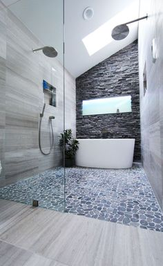 Dual rain shower heads, digital shower valve, stack stone wall, freestanding tub in shower ~ http://ever-unfolding.net/best-rain-shower-head-reviews/