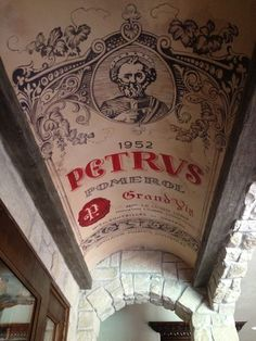 Wine cellar ceiling reproducing the label of a famous Bordeaux wine: Petrus 1952