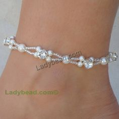 Custom Wedding White Pearl Crystal Rhinestones Bling for your ankle! Order as pictured or select your pearl color Ladybead Designs Anklets are made 9 unless otherwise requested. Made in the USA Item# A27 Sold per piece. Self closing clasp Swarovski 4mm & 6mm Pearl with Swarovski 6mm Rhinestone beaded anklet. Use the text box for any custom request to us. Anklets are made to order.