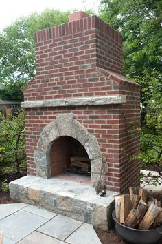 Outdoor fireplace, like the mixture of brick and stone.
