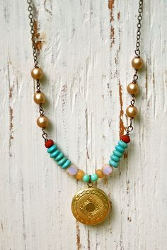 Charlise...  had her own style   features assorted glass beads,brass locket,antique brass chain  measures 28. This necklace looks fabulous alone