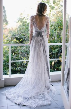Gray tones are perfect for a fall wedding. And the sheer sleeves and floating flowers are calling our names 20 Long-Sleeved Wedding Dresses via Brit + Co.