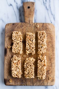 8 Ingredient Honey Nut Cheerio Bars. Simple and easy these are the perfect anytime snack or even breakfast on the go!| halfbakedharvest.com