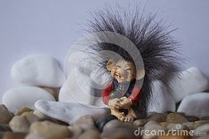 Beautiful background with a cute troll and stones Troll, Lion Sculpture, Stones, Statue, Cute, Beautiful, Rocks, Kawaii, Sculptures