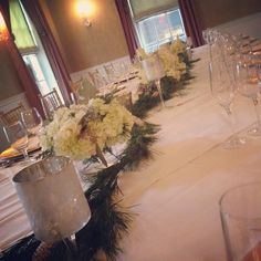 winter white refectory table with mercury glass and three arrangements of winter white flowers, including white hydrangea, white roses, silver brunia, and pine White Roses, White Flowers, Mercury Glass, Winter White, Hydrangea, Wedding Events, Pine, Floral Design, Table Decorations