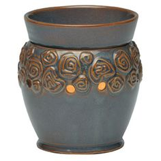Enchanted Mid-Size Scentsy Warmer    Embossed, artsy roses encircle a base of smoky amethyst over ochre, creating a modern yet romantic mood in any room.