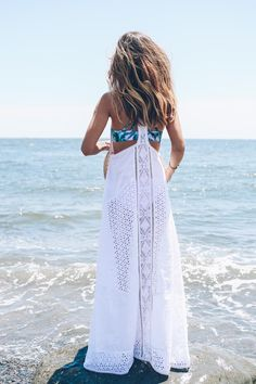 A day at the beach in a white maxi dress and palm print bikini.