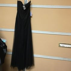 Vera wang strapless gown black Sz 2 Brand new but has lil damage on it from the sun as seen in last pic not obvious but it's there and also the boning is bent again no boggie when worn original price was $800 Vera Wang Dresses Maxi