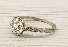 Baguette and round combination. This vintage sparkler would complement sooo many of Happily Ever Borrowed's pieces!