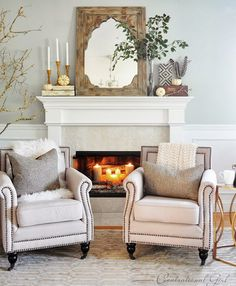so cozy. love the fur throw, feathers, greenery and candles in the fireplace