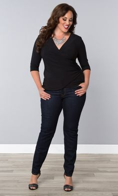 272556a9080c2 Feel fresh and fabulous in our plus size Femme Fatale Faux Wrap Top.  Perfect for