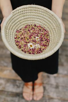 Each guest was given a sea grass pouch filled with dried chamomile and rose petals to throw at us as we walked up the aisle, taking our first steps as husband and wife.