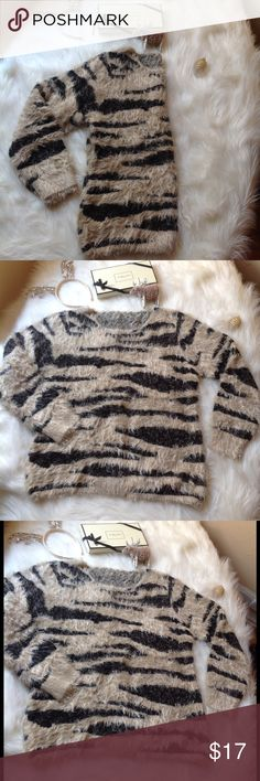 """Animal print fuzzy sweater size M, soft & cozy Latest trend 😊Animal print fuzzy sweater size M. Super soft and cozy. Chest width 20"""". Length 26"""". Sweater is stretchy. There are no labels or tags because it was purchased at a sample sale in NYC but it is brand new, it has never been worn. True to size. 🛍 bundle and save. 15% off on orders of 3 or more items. Sweaters Crew & Scoop Necks"""