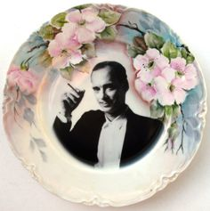 Campy director and flowers. A John Waters plate. Awesome & kitchy :)