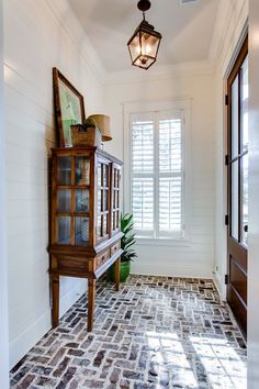 Brick floor - love - Smythe Park Home in Daniel Island, SC by JacksonBuilt Custom Homes