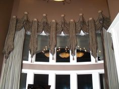 """Custom panels with decorative swags on medallions. """"Tie Jabots"""" of different sizes soften these oversize windows. Upholstered Furniture, Custom Furniture, Drapery, Curtains, Window Styles, Valances, Interior Design Services, Fabric Decor, Window Treatments"""