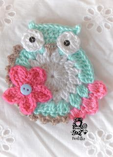 Love this crocheted owl.  Would make a cute pin.