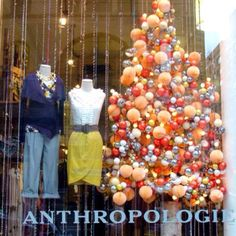 Anthropologie Holiday Window Display...and I want that outfit. yes, the yellow skirt. I want it.