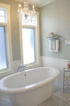 "Soaker tub. Pretty & fresh bathroom. Soft, soothing wall color is ""Silver Sage"" by Restoration Hardware. Benjamin Moore's ""Grey Wisp"" is a comparable color."