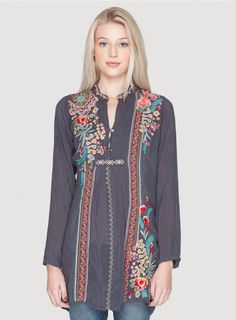 Sheela Tunic The Johnny Was SHEELA TUNIC is the ultimate bohemian statement piece! This tunic top features a colorful Folk Art-inspired embroidery design that details the entire front and back placket. With a three-button henley front, long sleeves, and pintucked front details, this boho tunic is as figure-flattering as it is unique!  - Rayon Georgette - Three Button Henley Front, Long Sleeves, Tunic Length - Signature Embroidery - Care Instructions: Machine Wash Cold, Tumble Dry Low…