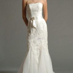 Alexis Strapless lace gown with sheath fit. Satin band around waist with bow and broach. Anyabridal.com