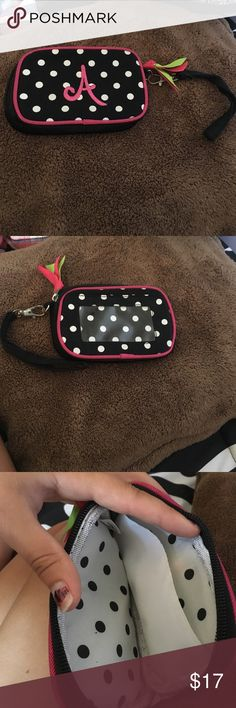 Small wristlet from Mudpie It is an initialized small wristlet that has been barely used. It has an ID placement in the back and can hold enough for a night out! It still has a lot of life left in it. Mudpie Bags Clutches & Wristlets