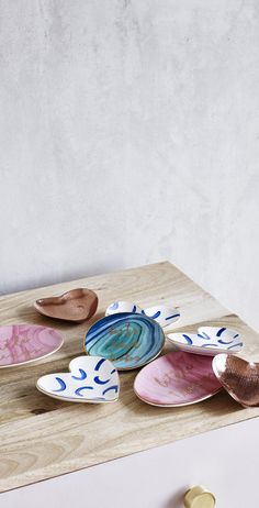 Keep your most treasured pieces close to your heart on this blue Trinket Dish.
