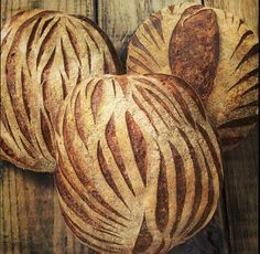Scoring as texture, evocative of waving field of wheat, oak tree park, what do you think of? 100% NC-grown-and-ground wheat sourdough from Chicken Bridge Bakery ([@]ChickenBridgeBa), pinned with their permission.