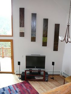 Hang Art At Diffe Levels To Make Use Of Walls With Vaulted Ceilings We