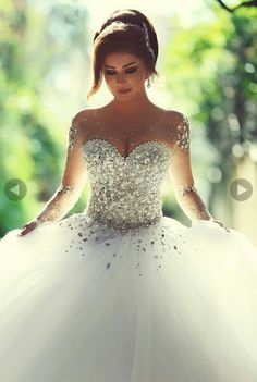 I'm not a fan of poofy, Cinderella dresses BUT this is probably one of the most gorgeous one's I've seen! Could even change my mind about these kind of dresses.