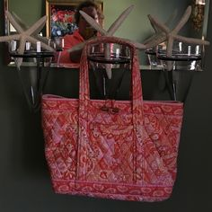 """VERA BRADLEY SHERBET TOTE BAG Vera Bradley sherbet tote bad in great condition beautiful orange and pink paisley bag top of one strap shows some little fading no bad but want to be honest other than than it is great  it is about 16"""" long Vera Bradley Bags Shoulder Bags"""