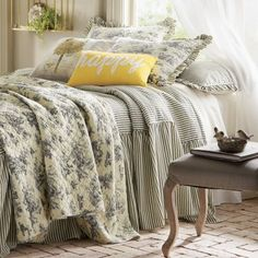 Bedspread and shams in tan and black-striped ticking...Bring in color with additional pillows (Euro and throw). (358 w/o extra pillows)