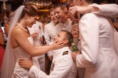 The boys sing a traditional Navy song to the beautiful bride. {W&WK} [Nicholas Gore Photography]
