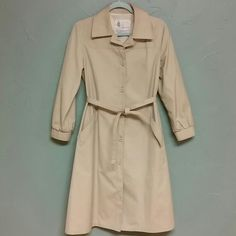 Vintage London Fog Trench coat Beautiful London Fog Trench coat in amazing condition.  There are a couple of tiny spots on the back (see pic) and a few on the front but overall this is in excellent condition and with a good wash should be like brand new.  Also water repellant. London Fog Jackets & Coats Trench Coats