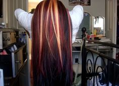 Brunette with red and blonde highlights.