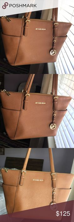 Michael Kors Jet Set Large Top Zip Saffiano Tote I love this bag!! I have had it for two years and took very good care of it. I just don't use it often anymore. I do have the duster it came with. Bought from a Michael Kors Store. Michael Kors Bags Totes