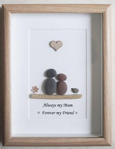 This is a beautiful small Pebble Art framed Picture of a Mother and Child - Always my Mum, forever my Friend handmade by myself using Pebbles, Driftwood and Wooden Heart Size of Picture incl Frame : approx. 22cm x 17cm This Picture is finished and only available as shown in Photo Thanks