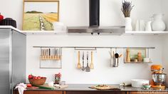 Clear-up counter space by hanging cooking utensils.